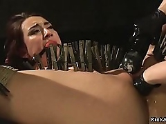 Young lesbian in hawser cocoon bondage standing gagged and obtaining whipped by mistress then obtaining pussy fisted regarding clamped body